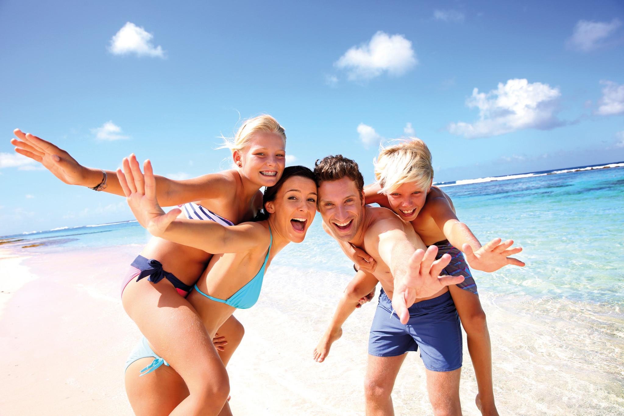 bigstock-family-of-four-having-fun-at-t-45299944